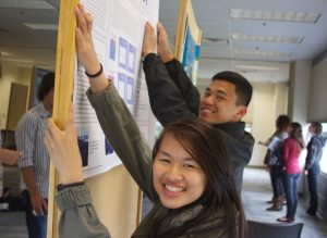 Students from James Logan High School put up their poster at the Monterey Bay Currents Symposium where they will present the scientific results of their LiMPETS Science Communication project