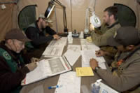 Four U.S. Fish and Wildlife Service biologists reviewing data around a table.